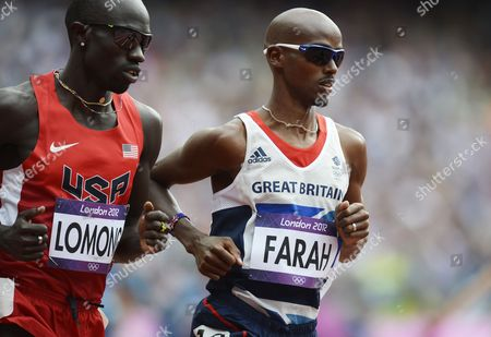 Mohamed Farah of Britain (r) and Lopez Lomong of the Us Competing in the Men's 5000m Heats at the London 2012 Olympic Games Athletics Track and Field Events at the Olympic Stadium London Britain 08 August 2012 Farah Placed Third in Heat 1 While Lomong Came in Fourth United Kingdom London