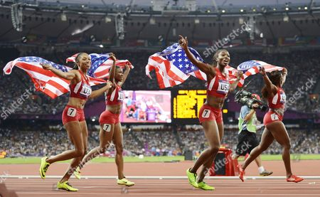 (from Left) Allyson Felix Carmelita Jeter Tianna Madison and Bianca Knight of the Us Celebrate After Winning the Women's 4x100m Relay at the Olympic Stadium London Britain 10 August 2012 United Kingdom London
