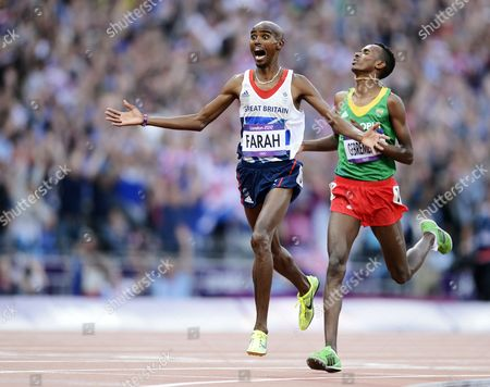 Britain's Mohamed Farah (l) Beats Dejen Gebremeskel (r) of Ethiopia to Second Place to Win the Men's 5000m Final at the London 2012 Olympic Games Athletics Track and Field Events at the Olympic Stadium London Britain 11 August 2012 United Kingdom London