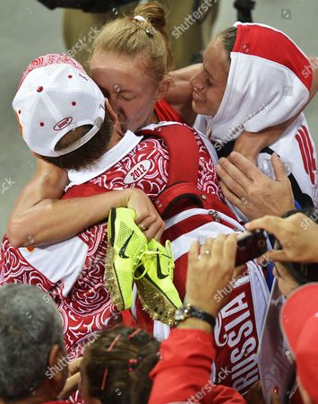 Stock Photo of Yuliya Zaripova of Russia (facing Centre) Celebrates with Members of Team Russia After Winning the Women's 3000m Steeplechase Final at the London 2012 Olympic Games Athletics Track and Field Events at the Olympic Stadium London Britain 06 August 2012 United Kingdom London