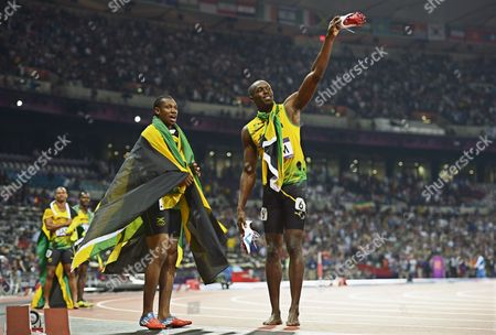Yohan Blake (foreground Left) and Usain Bolt of Jamaica Celebrate After Jamaica Won the Men's 4x100m Final at the London 2012 Olympic Games Athletics Track and Field Events at the Olympic Stadium London Britain 11 August 2012 in Background Left Are Their Teammates Michael Frater and Nesta Carter United Kingdom London