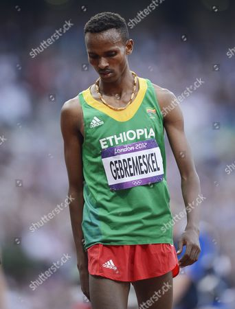Dejen Gebremeskel of Ethiopia Walks Off After Placing Second in the Men's 5000m Final at the London 2012 Olympic Games Athletics Track and Field Events at the Olympic Stadium London Britain 11 August 2012 United Kingdom London