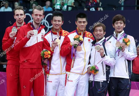 (l-r) Silver Medalists Mathias Boe (l) and Carsten Mogensen (2l) of Denmark ; Gold Medalists Yun Cai (3 L) and Haifeng Fu (3 R) of China and Bronze Medal Winners Jae Sung Chung (2r) and Yong Dae Lee (r) of Korea Celebrate After the Badminton Men's Doubles Final at the London 2012 Olympic Games Badminton Competition London Britain 05 August 2012 United Kingdom London