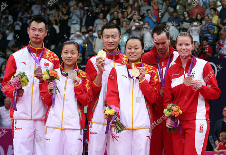 (l-r) Silver Medalists Chen Xu and Jin Ma and Gold Medalists Nan Zhang and Yunlei Zhao All of China and Bronze Medalists Joachim Fischer and Christinna Pedersen of Denmark Celebrate After the Badminton Mixed Doubles Final During the London 2012 Olympic Games London Britain 03 August 2012 United Kingdom London