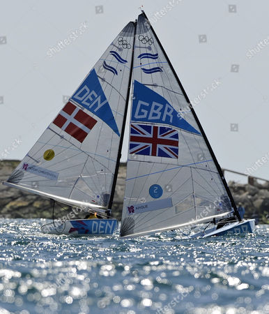 Ben Ainslie of Great Britain (r) Challenges Jonas Hogh-christensen of Denmark(l) in the Men's Finn Class Medal Race During the London 2012 Olympic Games Sailing Competition in Weymouth Britain 05 August 2012 Weymouth is Hosting the Sailing Competition For the London 2012 Olympic Games From 27 July to 12 August 2012 Ainslie Won the Gold Medal and Jonas Hogh-christensen the Silver United Kingdom Weymouth
