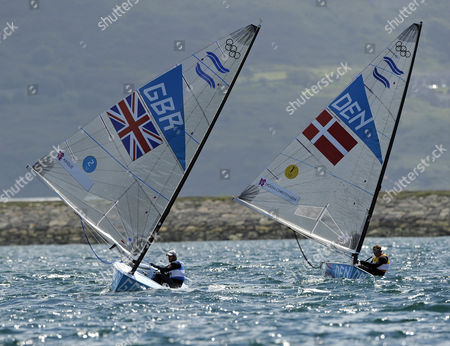 Ben Ainslie of Great Britain (l) Challenges Jonas Hogh-christensen of Denmark (r) in the Men's Finn Class Medal Race During the London 2012 Olympic Games Sailing Competition in Weymouth Britain 05 August 2012 Weymouth is Hosting the Sailing Competition For the London 2012 Olympic Games From 27 July to 12 August 2012 Ainslie Won the Gold Medal and Jonas Hogh-christensen the Silver United Kingdom Weymouth