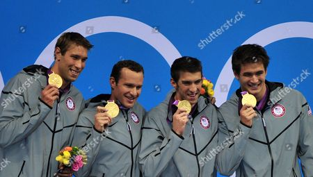 Usa (l-r: Matthew Grevers Brendan Hansen Michael Phelps Nathan Adrian) Team with the Gold Medal During the Medal Ceremony of the Men's 4 X 100m Medley Relay at the London 2012 Olympic Games Swimming Competition London Britain 04 August 2012 United Kingdom London