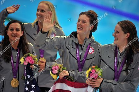 Us Swimmers Missy Franklin (r) Rebecca Soni (l) Dana Vollmer (2l) and Allison Schmitt (2r) During the Medal Ceremony After Winning the Gold Medal in the Women's 4x100m Medley Relay During the London 2012 Olympic Games Swimming Competition London Britain 04 August 2012 United Kingdom London