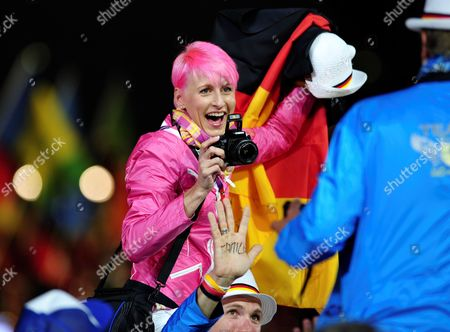 Stock Photo of German High Jumper Ariane Friedrich Takes a Picture During the Closing Ceremony of the London 2012 Olympic Games London Britain 12 August 2012 United Kingdom London