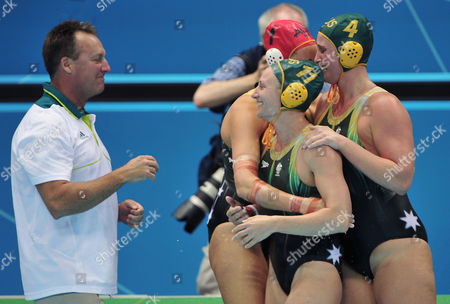 Australian Team's Coach Greg Mcfadden (l) Mel Rippon (c) Holly Lincoln-smith (r) and Victoria Brown (rear) of Australia Celebrate After a Penalty Shootout Against China in the Women's Water Polo Quarterfinal Match During the London 2012 Olympic Games Water Polo Competition London Britain 05 August 2012 United Kingdom London