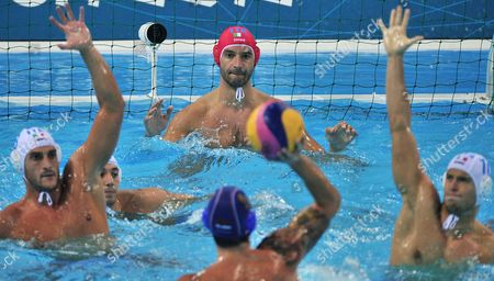 Italy Goalkeeper Stefano Tempesti (c) with Teammates Valentino Gallo (l) and Deni Fiorentini (r) in Action Against Serbia's Nikola Raden (b) During the Men's Semifinal at the London 2012 Olympic Games Water Polo Competition London Britain 10 August 2012 United Kingdom London