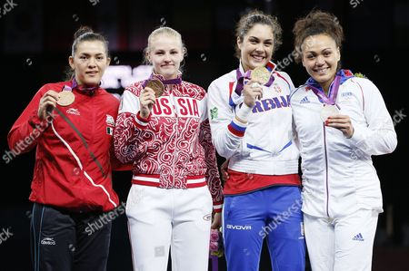 (l-r) Maria Del Rosario Espinoza of Mexico and Anastasia Baryshnikova of Russia (bronze) Milica Mandic of Serbia (gold) and Anne-caroline Graffe of France (silver) From the Women +67kg Gold Medal Final Taekwondo at the Excel Centre in the London 2012 Olympic Games 11 August 2012 United Kingdom London