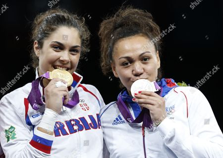 Milica Mandic of Serbia on the Winner's Podium with Her Gold Medal and Anne-caroline Graffe of France (r) with Her Silver Medal From the Women +67kg Gold Medal Final Taekwondo at the Excel Centre in the London 2012 Olympic Games 11 August 2012 United Kingdom London