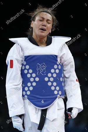 Stock Picture of Anne-caroline Graffe of France (blue) Reacts After Losing to Milica Mandic of Serbia (red) in the Women's +67kg Gold Medal Final Taekwondo at the Excel Centre in the London 2012 Olympic Games 11 August 2012 United Kingdom London