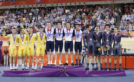 Edward Clancy Geraint Thomas Steven Burke and Peter Kennaugh of Britain's Men's Pursuit Team (c) Pose with Ther Gold Medals Australia's Men Team Pursuit Team Including Jack Bobridge Glenn O'shea Rohan Dennis and Michael Hepburn (l) Celebate Their Silver Medal and New Zealand's Men Team Pursuit Team Including Sam Bewley Westley Gough Marc Ryan and Jesse Sergent (r) Pose with Their Bronze Medals After the Men's Team Pursuit Final the London 2012 Olympic Games Track Cycling Competition London Britain United Kingdom London