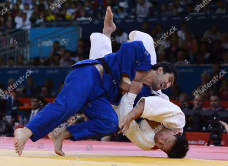 Tagir Khaibulaev of Russia (blue) Takes Down Tuvshinbayar Naidan of Mongolia to Win the Gold Medal During the -100 Kg Judo Finals of the London 2012 Olympic Games Judo Competition London Britain 02 August 2012 United Kingdom London