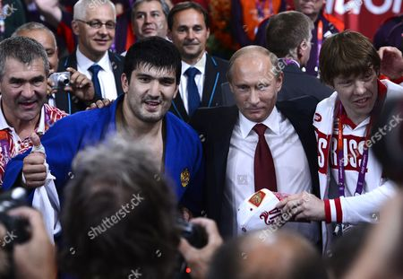 Russian Judo Player Tagir Khaibulaev (2nd L) with President Vladimir Putin of the Russian Federation After Winning the Gold Medal During Men's Judo 100k at Excel Arena For the London 2012 Olympic Games Judo Competition London Britain 02 August 2012 United Kingdom London