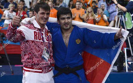 Tagir Khaibulaev of Russia (r) and Team Member Khansanbi Taov Celebrate the Gold Medal After Winning the Men's -100kg Judo Final During the London 2012 Olympic Games London Britain 02 August 2012 United Kingdom London