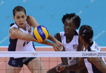 Stock Photo of Logan Tom of the Usa (l) Hits the Ball As Teammates Megan Hodge (c) and Danielle Scott-arruda (r) Look on in Their Match with China During Volleyball Preliminary Rounds at Earls Court For the London 2012 Olympic Games Volleyball Competition London Britain 01 August 2012 United Kingdom London