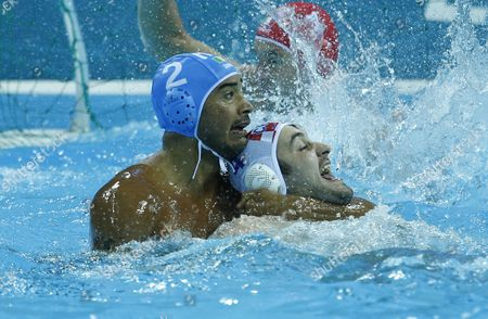 Italy's Amaurys Perez (blue) Grabs Croatia's Niksa Dobud (white) by the Neck During the London 2012 Olympic Games Men's Water Polo Gold Medal Final at Water Polo Arena London Great Britain 12 August 2012 United Kingdom London