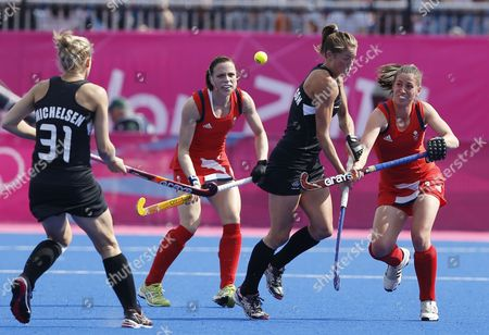 Great Britain's Kate Walsh (l) and Emily Maguire (r) Challenge New Zealand's Ella Gunson During the London 2012 Olympic Games Women's Hockey Bronze Medal Match at the Riverbank Arena London Great Britain 10 August 2012 United Kingdom London