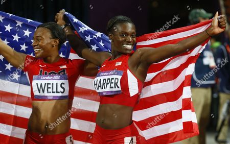 Dawn Harper (r) and Kellie Wells of the Us Celebrate After Placing Second and Third Respectively in the 100m Hurdles Final at the London 2012 Olympic Games Athletics Track and Field Events at the Olympic Stadium London Britain 07 August 2012 United Kingdom London