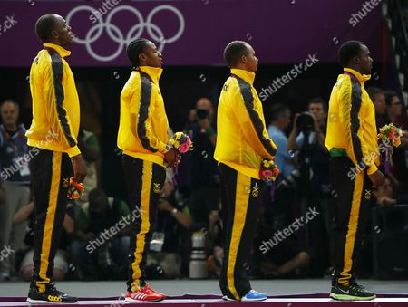 Stock Photo of (l-r) Jamaica's Usain Bolt Yohan Blake Michael Frater and Nesta Carter Celebrate Winning the Gold Medal in the Men's 4 X 100m Relay Final During the London 2012 Olympic Games Athletics Track and Field Events at the Olympic Stadium London Britain 11 August 2012 United Kingdom London