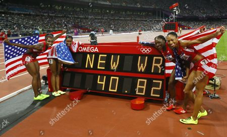 (from Left) Tianna Madison Carmelita Jeter Bianca Knight and Allyson Felix of the Us Celebrate After Winning the Women's 4x100m Relay at the Olympic Stadium London Britain 10 August 2012 the Us Team Won in New World Record Time of 40 82 Seconds United Kingdom London