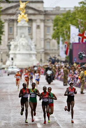 Edna Ngeringwony Kiplagat (l) of Kenya Tiki Gelana (2nd L) of Ethiopia Mary Jepkosgei Keitany (c) of Kenya Mare Dibaba (2nd R) of Ethiopia and Priscah Jeptoo (r) of Kenya Compete During the Women's Marathon in the London 2012 Olympic Games Marathon Competition London Britain 05 August 2012 Tiki Galena Won the Gold Medal United Kingdom London