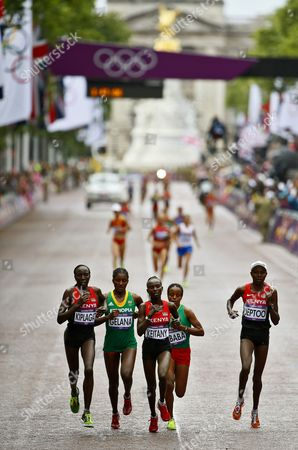Edna Ngeringwony Kiplagat (l) of Kenya Tiki Gelana (2nd L) of Ethiopia Mary Jepkosgei Keitany (c) of Kenya Mare Dibaba (2nd R) of Ethiopia and Priscah Jeptoo (r) of Kenya Compete During the Women's Marathon in the London 2012 Olympic Games Marathon Competition London Britain 05 August 2012 Tiki Gelana Won the Gold Medal United Kingdom London