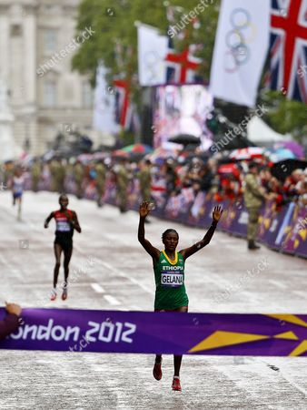 Tiki Gelana (front) of Ethiopia Run to Win in Front of Priscah Jeptoo (rear) of Kenya in the Women's Marathon During the London 2012 Olympic Games Athletics Marathon Competition London Britain 05 August 2012 United Kingdom London
