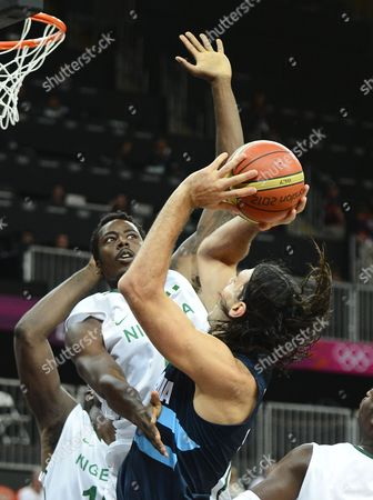 Argentina Player Luis Scola (f) Takes a Shot Against Nigeria Player Al-farouq Aminu (b) in the First Half of Their Game at the London 2012 Olympic Games in London Great Britain 04 August 2012 United Kingdom London