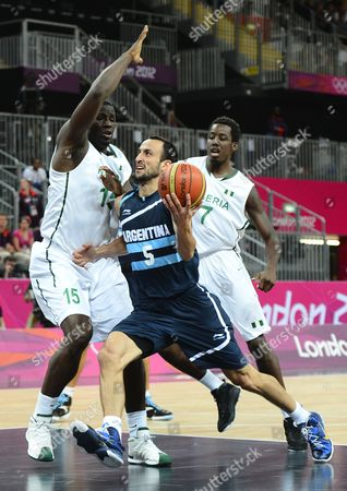 Argentina Player Manu Ginobili (c) Drives the Ball Against Nigeria Players Olumide Oyedeji (l) and Al-farouq Aminu (r) in the First Half of Their Game at the London 2012 Olympic Games in London Great Britain 04 August 2012 United Kingdom London
