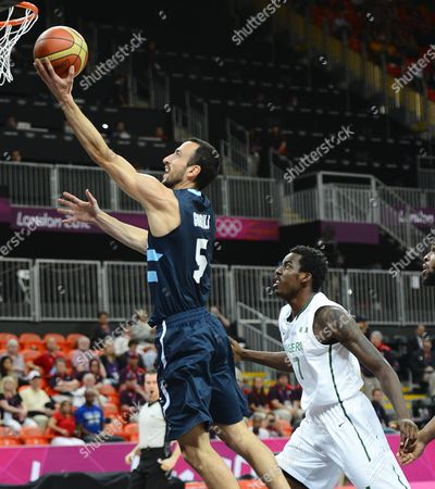 Argentina Player Manu Ginobili (l) Goes to the Basket Against Nigeria Player Al-farouq Aminu (r) in the First Half of Their Game at the London 2012 Olympic Games in London Great Britain 04 August 2012 United Kingdom London