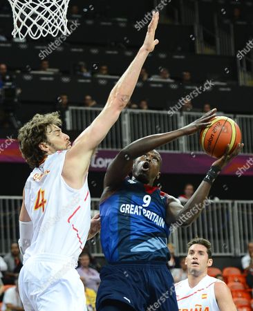 Great Britain Player Luol Deng (r) Goes to the Basket Against Spain Player Pau Gasol (l) During the Preliminary Round Match Between Spain and Argentina in the London 2012 Olympic Games Basketball Competition London Britain 02 August 2012 United Kingdom London