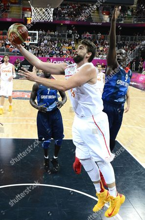 Spain's Marc Gasol Lays the Ball in Past Britain's Luol Deng (r) During Their Game in the London 2012 Olympic Games Basketball Competition London Britain 02 August 2012 United Kingdom London