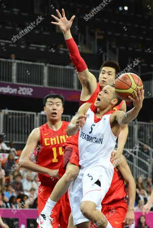 Great Britain's Andrew Lawrence (front) Goes to the Basket Against China's Ailun Guo (c) and Zhizhi Wang (l) in the Second Half of Their Game at the London 2012 Olympic Games Basketball Competition in London Great Britain 06 August 2012 United Kingdom London