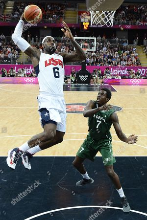 Lebron James of the Us Goes For a Dunk Past Nigeria's Al-farouq Aminu (r) During Their Game in the London 2012 Olympic Games Basketball Competition London Britain 02 August 2012 United Kingdom London