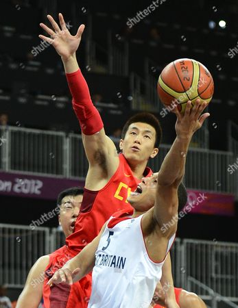Great Britain's Andrew Lawrence (front) Goes to the Basket Against China's Ailun Guo (c) and Zhizhi Wang (l) in the Second Half of Their Game at the London 2012 Olympic Games in London Great Britain 06 August 2012 United Kingdom London