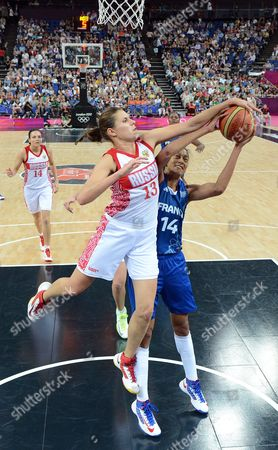 Russia's Anna Petrakova (l) Blocks a Shot by France's Emmeline Ndongue During Their Semifinals Game at the London 2012 Olympic Games Basketball Competition London Britain 09 August 2012 United Kingdom London