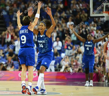 France Player Celine Dumerc (l) Along with Emmeline Ndongue (c) Reacts After Winning Against Russia in Their Semifinals Game at the London 2012 Olympic Games in London Great Britain 09 August 2012 the London 2012 Olympic Games Basketball Competition London Britain United Kingdom London