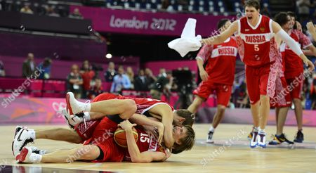 Russia Player Andrei Kirilenko (bottom) Celebrates with Teammates Sergey Monya (top) After Winning the Game Against Argentina in Their Bronze Medal Game at the London 2012 Olympic Games in London Great Britain 12 August 2012 United Kingdom London