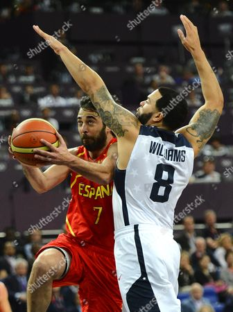 United States of America Player Deron Williams (r) Tries to Block a Shot Against Spain Player Juan-carlos Navarro (l) in the First Half of Their Gold Medal Game at the London 2012 Olympic Games in London Great Britain 12 August 2012 United Kingdom London
