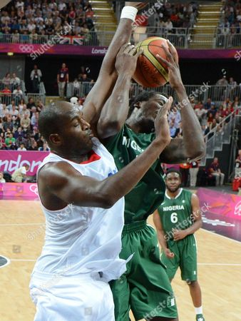 France's Ali Traore (l) Tries to Stop Nigeria's Al-farouq Aminu From Taking the Ball to the Basket in the First Half of the Game For the London 2012 Olympic Games Basketball Competition London Britain 06 August 2012 United Kingdom London