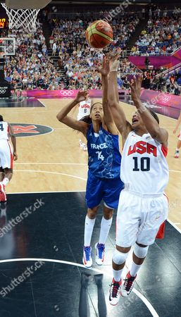 Usa's Tamika Catchings (r) Shoots Over France's Emmeline Ndongue (l) During the First Half of Their Gold Medal Game at the London 2012 Olympic Games Basketball Competition London Britain 11 August 2012 United Kingdom London