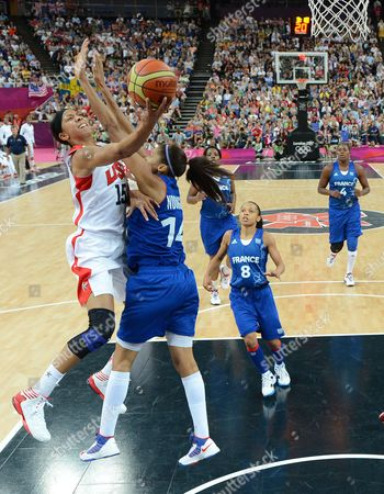 Usa's Candace Parker (l) Shoots Over France's Emmeline Ndongue (r) During the First Half of Their Gold Medal Game at the London 2012 Olympic Games Basketball Competition London Britain 11 August 2012 United Kingdom London