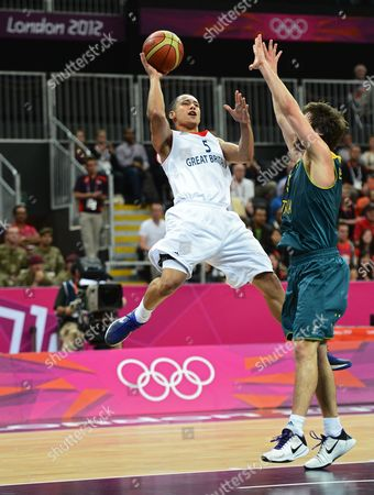 Great Britain Player Andrew Lawrence (l) Goes to the Basket Against Australia Player Matt Nielsen (r) in the Second Half of Their Game at the London 2012 Olympic Games in London Great Britain 04 August 2012 United Kingdom London