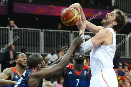 Great Britain Player Luol Deng (l) Tries to Knock the Ball Loose Against Spain Player Pau Gasol (r) in the Second Half of Their Group Game at the London 2012 Olympic Games Basketball Competition London Britain 02 August 2012 Epa/larry W Smith United Kingdom London