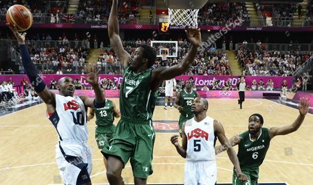 Kobe Bryant (l) of the Usa Goes to the Basket Against Al-farouq Aminu of Nigeria During the Preliminary Round Match Between Usa and Nigeria in the London 2012 Olympic Games Basketball Competition London Britain 02 August 2012 United Kingdom London