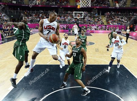 Russell Westbrook of the Us Drives Between Nigeria's Derrick Obasohan (r) and Al-farouq Aminu (l) During Their Game in the London 2012 Olympic Games Basketball Competition London Britain 02 August 2012 United Kingdom London